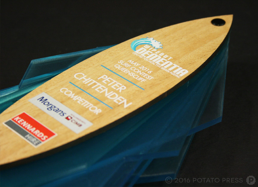 potato-press-wipeout-dimentia-wooden-trophy-award-layered-acrylic-uv-printed-surf-board-detail